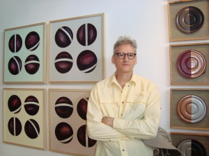"me at the Morean. The ""Rotational Series"" (on left) is technically not a cutout but it belongs with them. The circles are quasi-cutout as they are rendered in oil paint over acrylic enamel fields, and look as though they are cut and pasted."